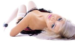 Beauty sexy blonde in corset lay on white Royalty Free Stock Photo