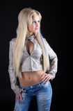 Beauty sexy blonde in leather jacket and jeans Royalty Free Stock Photos