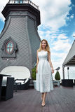 Beauty sexy business woman in restaurant in white fashion dress Royalty Free Stock Image