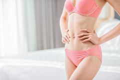 Beauty sexy woman body. Beauty sexy slim woman body at home royalty free stock image