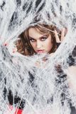 Beauty Witch girl caught in a spider web. Fashion Art design. Beautiful Gothic model girl with Halloween make up. And costume royalty free stock photography