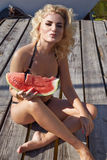 Beauty sexy woman body sun tan skin watermelon summer swimsuit Royalty Free Stock Image