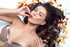 Beauty sexy woman brunette candy sweet makeup Stock Images