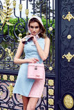 Beauty woman fashion model glamour style clothes. Casual dress for party and office accessory lather bag and silk wrap brand sunglasses street look garden yard royalty free stock images