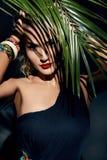 Beauty sexy woman makeup jungle palm sun tan shadows beach Stock Images