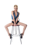 Beauty sexy woman posing on bar chair Royalty Free Stock Image