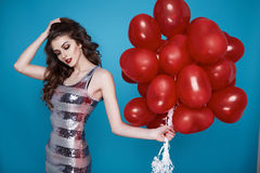 Beauty sexy woman with red heart baloon Valentines day birthday Stock Photo