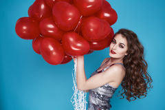 Beauty sexy woman with red heart baloon Valentines day birthday Stock Image