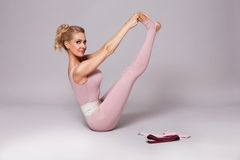 Beauty sexy woman sport yoga pilates fitness body shape clothes Royalty Free Stock Photos