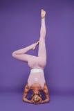 Beauty sexy woman sport yoga pilates fitness body shape clothes Stock Image