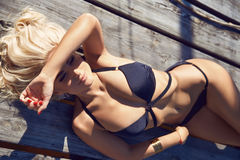 Beauty sexy woman swimming suit resort sun beach tan Royalty Free Stock Images