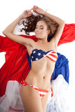 Beauty sexy woman in usa flag bikini on fabric Royalty Free Stock Images
