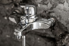 Beauty of shiny metal chrome surface on a bathroom tap with wate Stock Photography