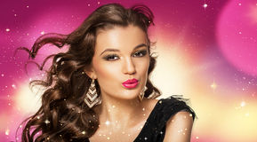 Beauty shoot of smart brunette woman in motion over colored back Royalty Free Stock Images