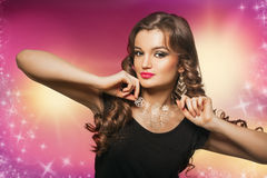 Beauty shoot of smart brunette woman in motion over colored background Royalty Free Stock Photography