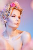 Beauty shoot of a woman in roses Royalty Free Stock Photography