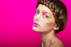 Beauty shooting with cubism makeup Stock Images