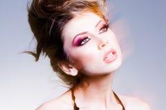 Beauty shot of beautiful blonde woman wearing professional make-up. On royalty free stock photo