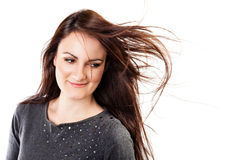 Beauty shot of beautiful brunette woman with long fluttering hai Royalty Free Stock Photo