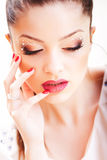 Beauty shot of beautiful woman face wearing professional make-up Stock Image