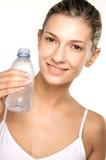 Beauty shot of girl drinking water. Beauty Shot looking at camera Royalty Free Stock Photography
