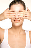 Beauty shot of girl hiding her eyes. Perfect skin smiling Royalty Free Stock Photography