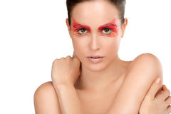 Beauty shot of model with artistic red make makeup an styling. On white stock photo