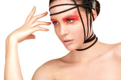 Beauty shot of model with artistic red make makeup an styling Royalty Free Stock Image