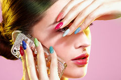 Beauty shot of model wearing colorful nail polish Royalty Free Stock Photos