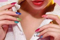 Beauty shot of model wearing colorful nail polish Royalty Free Stock Image