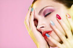 Beauty shot of model wearing colorful nail polish. On pink Stock Photo