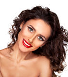 Beauty shot of a smiling long haired, beautiful brunette woman. Photo of beautiful nude fashion female model with professional makeup and hairstyle on white Royalty Free Stock Image