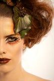 Beauty shot woman in autumn makeup Stock Photography