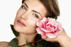 Beauty shot of woman with a beautiful rose Royalty Free Stock Images