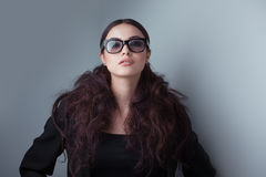 Beauty shot of a woman in stylish shades Stock Photography