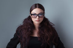 Beauty shot of a woman in stylish shades Stock Image