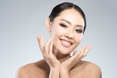 Beauty shot of young pretty asian woman with clear skin ongrey b. Ackground, for skin ad and cosmetology Royalty Free Stock Image