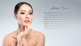 Beauty shot of young pretty asian woman with clear skin ongrey b. Ackground, for skin ad and cosmetology with copy space for text insertion Stock Photography