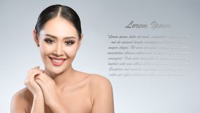 Beauty shot of young pretty asian woman with clear skin ongrey b. Ackground, for skin ad and cosmetology with copy space for text insertion Royalty Free Stock Images
