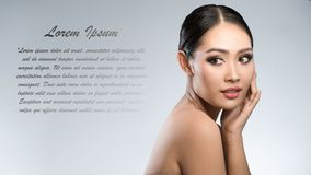 Beauty shot of young pretty asian woman with clear skin ongrey b. Ackground, for skin ad and cosmetology with copy space for text insertion Stock Photos