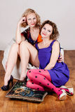 Beauty sisters in bright dress isolated on a white Stock Images