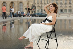 Beauty sitting in public Royalty Free Stock Photography