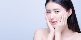 Beauty Skin Care Asian Woman Smile To You Isolated On Blue Background With Shy Emotional Stock Photography