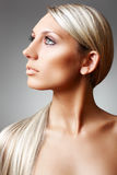 Beauty and skin care. Chic shiny blond long hair Stock Photos