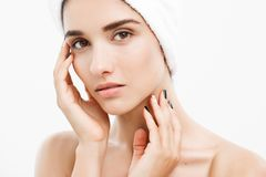 Beauty and Skin care concept - Close up Beautiful Young Woman touching her skin.  Stock Photography