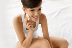 Beauty Skin Care. Woman Removing Face Makeup Using Cotton Pad Royalty Free Stock Images