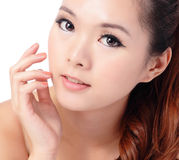 Beauty skin care woman smile and touching her face Stock Photos