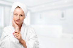 Beauty and skin care.  Woman  in white bathrobe and towels Stock Photos