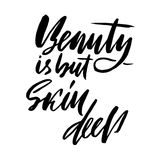 Beauty is but skin deep. Hand drawn lettering proverb. Vector typography design. Handwritten inscription. Royalty Free Stock Photos