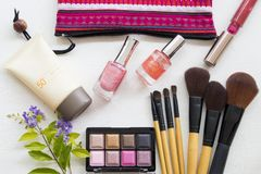 Beauty skin face cosmetic makeup for colorful woman. Brush ,eyes shadow ,lipstick ,sunscreen spf50 ,nail polish beauty skin face cosmetics makeup for colorful stock image